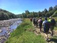 Walkers explore the River Avon.