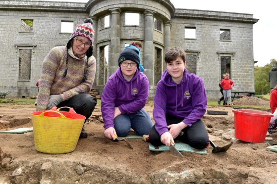 Pupils from New Pitsligo Primary helped with an archaeological dig near the Mansion House at Aden Country Park. (from left) volunteer Heather Jennings, New Pitsligo Primary pupils Ethan Alexander, 11 and Ayden Mitchell, 11. Picture by Colin Rennie.