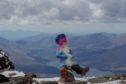 Artist Douglas Samson, creation on top of Ben Nevis. Picture by Andrew Cawley.