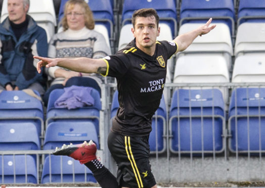 Nikolay Todorov celebrates scoring against Caley Thistle for Livingston in 2017.