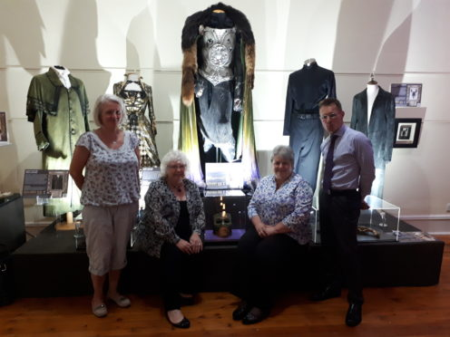 Pictured from left to right: councillors Lesley Berry, Anne Simpson, Anne Stirling and service manager for cultural services Craig Elliot with costumes from various magical movies