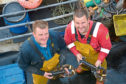 Finlay Ewen and Donald Macleod of Scalpay Shellfish were helped to market their catch