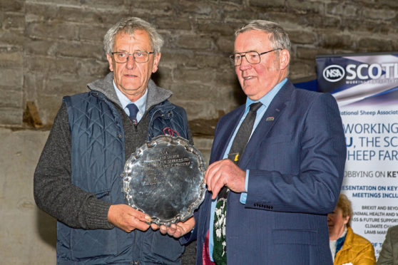 Colin MacGregor, (left), Lochearnhead, is presented with the NSA's Silver Salver by NFU Scotland president Andrew McCornick.