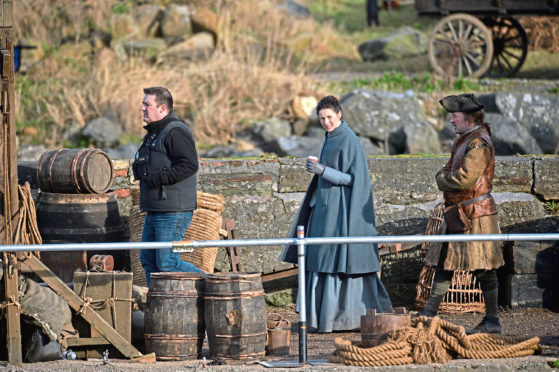Caitriona Balfe film scenes for the popular time travel series Outlander at Dunure Harbour near Ayr.