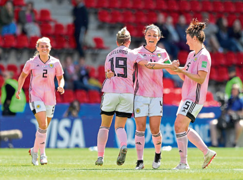 RENNES, FRANCE - JUNE 14: Lana Clelland of Scotland celebrates with teammates after scoring her team's first goal during the 2019 FIFA Women's World Cup France group D match between Japan and Scotland at Roazhon Park on June 14, 2019 in Rennes, France. (Photo by Richard Heathcote/Getty Images)