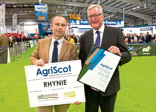 Last year's winner Donald Ross receiving his award from Rural Economy Secretary Fergus Ewing.