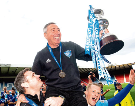 Peterhead manager Jim McInally lifts the Ladbrokes League 2 trophy