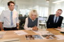 The Duchess of Rothesay (centre) looks at the next day's papers with Derry Aldritt and P&J editor Alan McCabe.