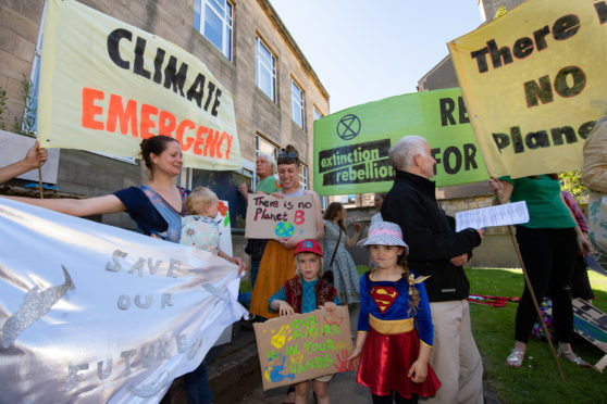 "Moray Council has declared a ""climate change emergency"". Pictured: Kate Mackay with Kai and Rachael Macintyre with Ossian."