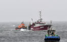 Fraserburgh lifeboat escorts Buckie-registered Conquest into Peterhead harbour