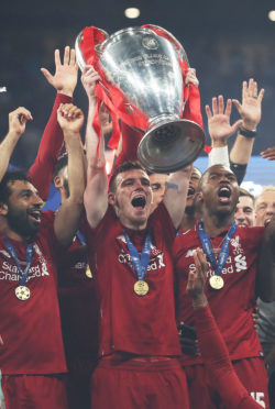 MADRID, SPAIN - JUNE 01: Andy Robertson of Liverpool  lifts the trophy during the UEFA Champions League Final between Tottenham Hotspur and Liverpool at Estadio Wanda Metropolitano on June 01, 2019 in Madrid, Spain. (Photo by Ian MacNicol/Getty Images)