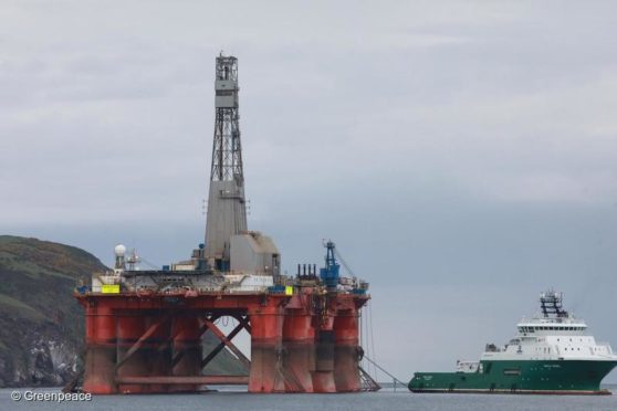 3 Greenpeace climbers on BP oil rig in Cromarty Firth, Scotland