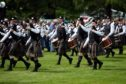 Piping Forres 2015 - European Pipe Band Championships at Grant Park, Forres. Marching off after competing.  Picture by Gordon Lennox 27/06/2015