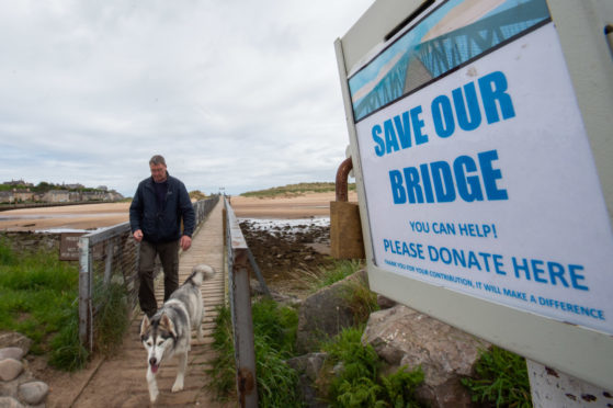 Pictures show the donation box at Lossiemouth footbridge running over to the East Beach.   Picture by Jason Hedges