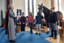 Rev Flora Munro and Ollie the horse during the service.