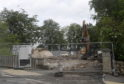 Demolition crews have begun tearing down the old Drumoak School