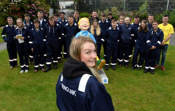 The 24 new Ringlink apprentices at the company sponsored Oor Wullie which is on display at Hazlehead Park, with apprentice Mhari Ross out front.