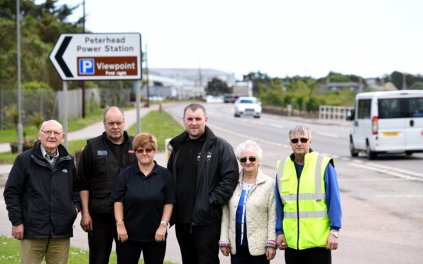 Left to right: Neil Wilson (resident), Alistair Fuerst (resident), Lynne Anderson (resident), Paul Anderson (owner Central Taxis), Irene Duncan (Community Council) and Irvine Simpson (community council) fear for their lives when it comes to the A90         Picture by Kami Thomson