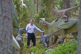 Dr Neil 'Jurassic' Clark, Curator of Palaeontology at University of Glasgow, officially opened the colossal gates to Dinosaur Kingdom at Landmark Adventure Park Carrbridge. Picture by Sandy McCook