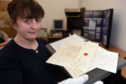 Assistant archivist Eilidh MacColl shows four letters from Anne Lister, Gentleman Jack, to her friend Lady Vere Cameron of Locheil.   pics by Sandy McCook