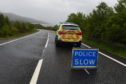 Police at the scene of the accident on the A96.