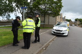 The scene at Doocot Park on Friday as police launched their investigation.