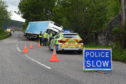 A lorry has veered off a road in Moray