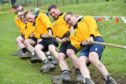 Keith young farmers dig in to victory in the tug-o-war competition.