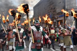 THE VIKINGS TORCH-LIT PARADE MARCHES THROUGH THE STREETS OF PORTSOY