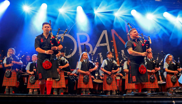 The Red Hot Chilli Pipers with Oban High School Pipe Band