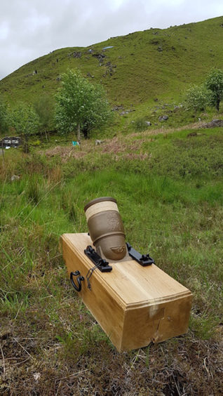 A relica Coehorn mortar near where archaeologists are working at Glenshiel
