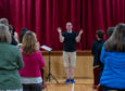 Dr Paul Whittaker, CBE takes a learn to sing in sign language workshop.