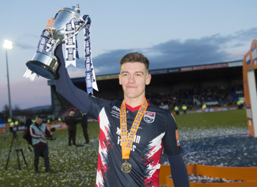 Ross County's Josh Mullin parades the trophy at full-time