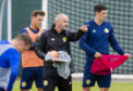 Aberdeen defender Scott McKenna, right, with Scotland manager Steve Clarke.