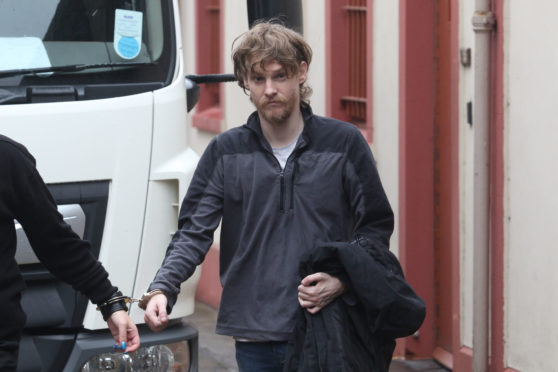 Simon Junor being taken from Inverness Sheriff Court.