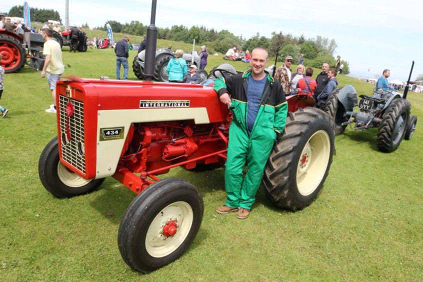 Douglas Johnstone with his International 434 tractor.