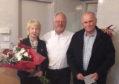 Community council chairman Bill Pitt between retiring members Barbara Anderson and Gordon Davidson