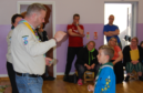 Ethan Brooks receives his special Three Peaks badge from the Scout's regional commissioner for the north-east of Scotland, Dougie Simmers.