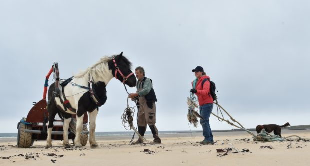 Simon Mulholland of Pony Access with his pony Obama and  Lauren Smith with dog Tattie at the Turning the Plastic Tide beach clean. Picture by Colin Rennie.
