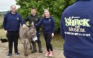 The cast of Shrek visited Willows and met Eeyore the donkey. Pictured (from left) is Scott Jamieson (Shrek), Michael Brown, animal husbandary and Hannah Smith (Sugar Plum Fairy)