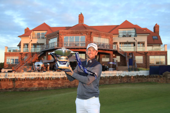 Bernd Wiesberger of Austria celebrates with the trophy following victory in the Aberdeen Standard Investments Scottish Open at The Renaissance Club on July 14, 2019 in North Berwick.