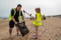School kids picking up litter from Aberdeen Beach with Scottish Water.