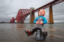 Travel spread in Your Weekend 11/07/19.  3/10/18 . The Sunday Post, by Andrew Cawley.  Pics of the Oor Wullie Bucket Trail statues in various locations in Glasgow and Edinburgh. Pic shows: Oor Wullie  in front of Forth Rail bridge.