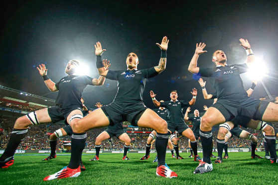 WELLINGTON, NEW ZEALAND - SEPTEMBER 13:  (L-R) Kieran Read, Aaron Smith and Aaron Cruden of the All Blacks perform the haka  during The Rugby Championship match between the New Zealand All Blacks and the South Africa Springboks at Westpac Stadium on September 13, 2014 in Wellington, New Zealand.  (Photo by Phil Walter/Getty Images)