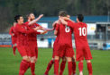 Brora's Martin MacLean celebrating with teammates after scoring