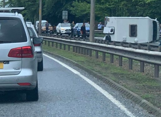 Rush-hour chaos after campervan crashes onto its side north of Kessock Bridge | Press and Journal