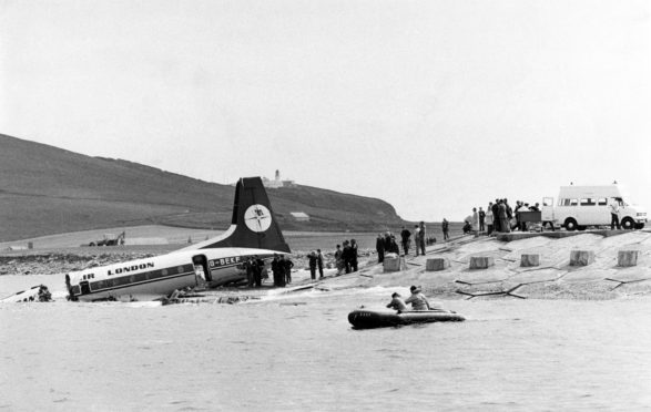 The rear section of the Dan-Air aircraft. The front section can be seen almost submerged at the left of the picture.