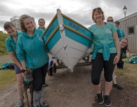 Burghead club members with their boat.