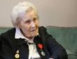 Helene Aldwinckle with the insignia of a Knight of the Légion d'honneur and her Bletchley Park Veteran badges.