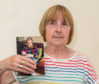 Kathleen Walker with a picture of her sister Jean Robertson who died at Dr Grays Hospital in Elgin.
